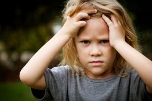 Portrait of sad shaggy child